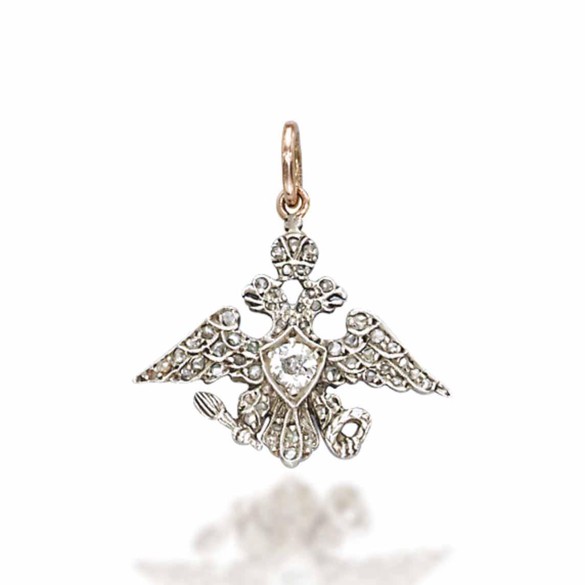 A DIAMOND PENDANT, BY FABERGÉ