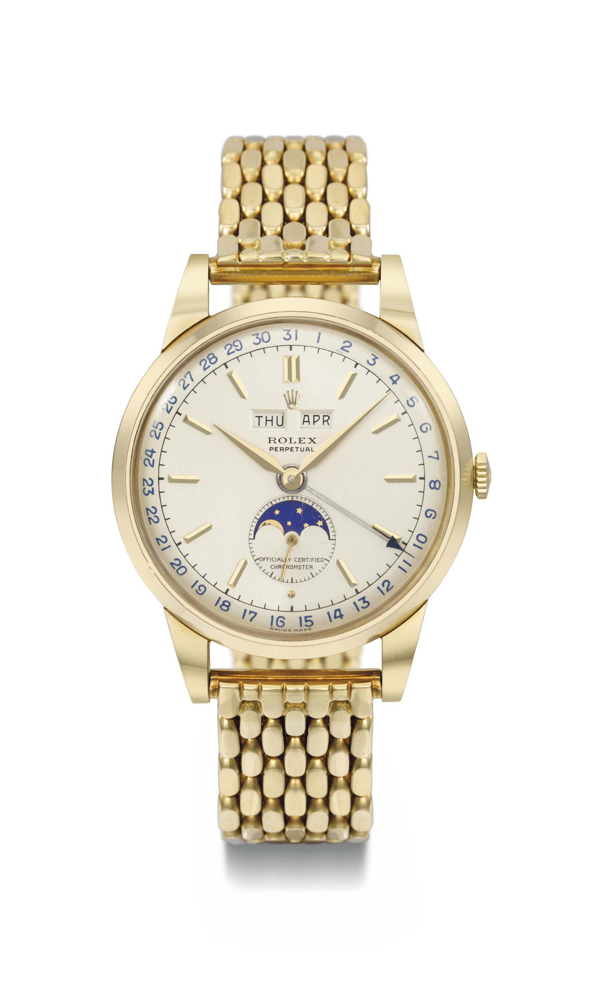 Rolex. An extremely fine and attractive 18K gold automatic triple calendar wristwatch with moonphase, two-tone silvered dial and bracelet