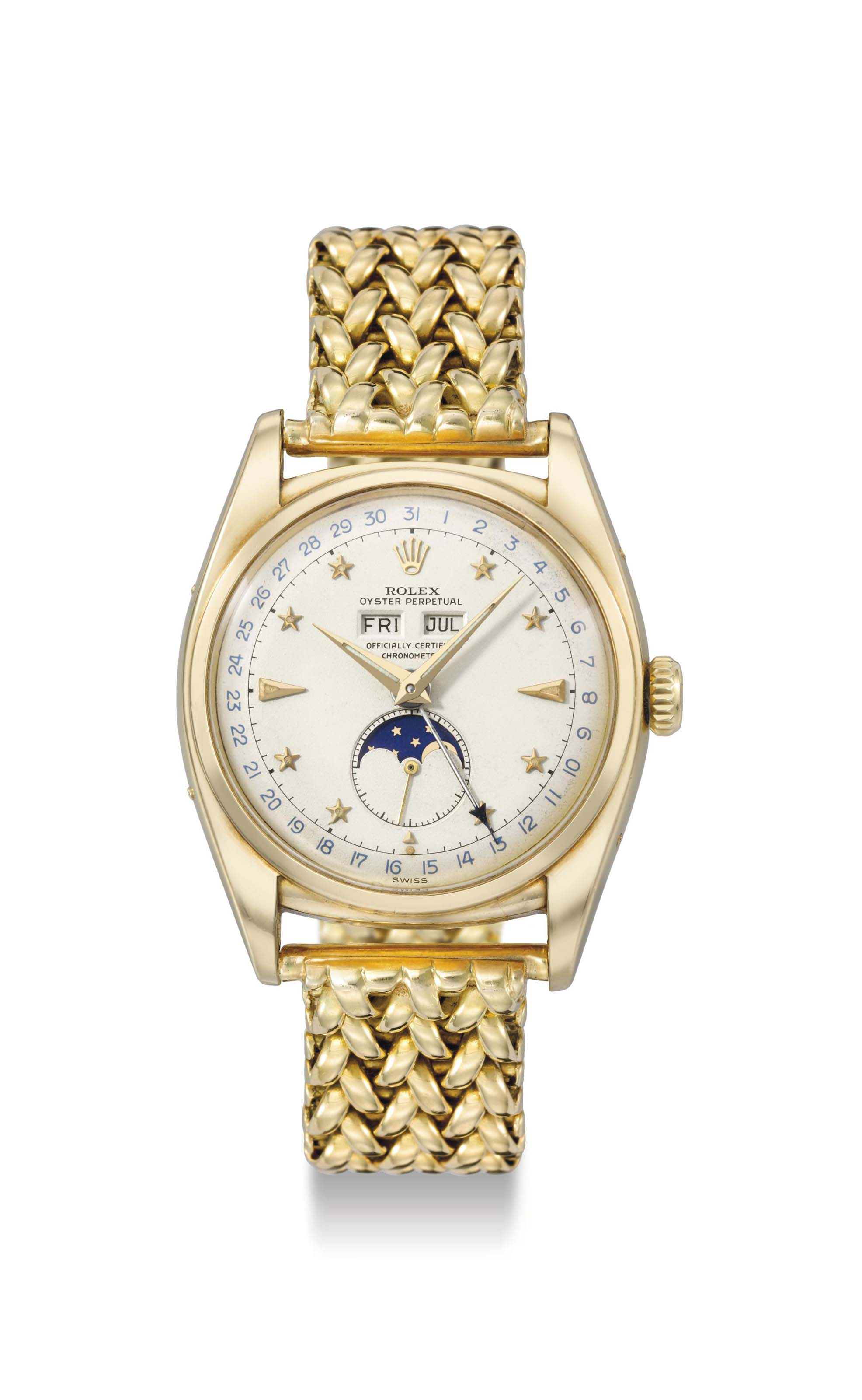 Rolex. A very rare, attractive and important 18K gold automatic triple calendar wristwatch with moon phases, bracelet and star dial