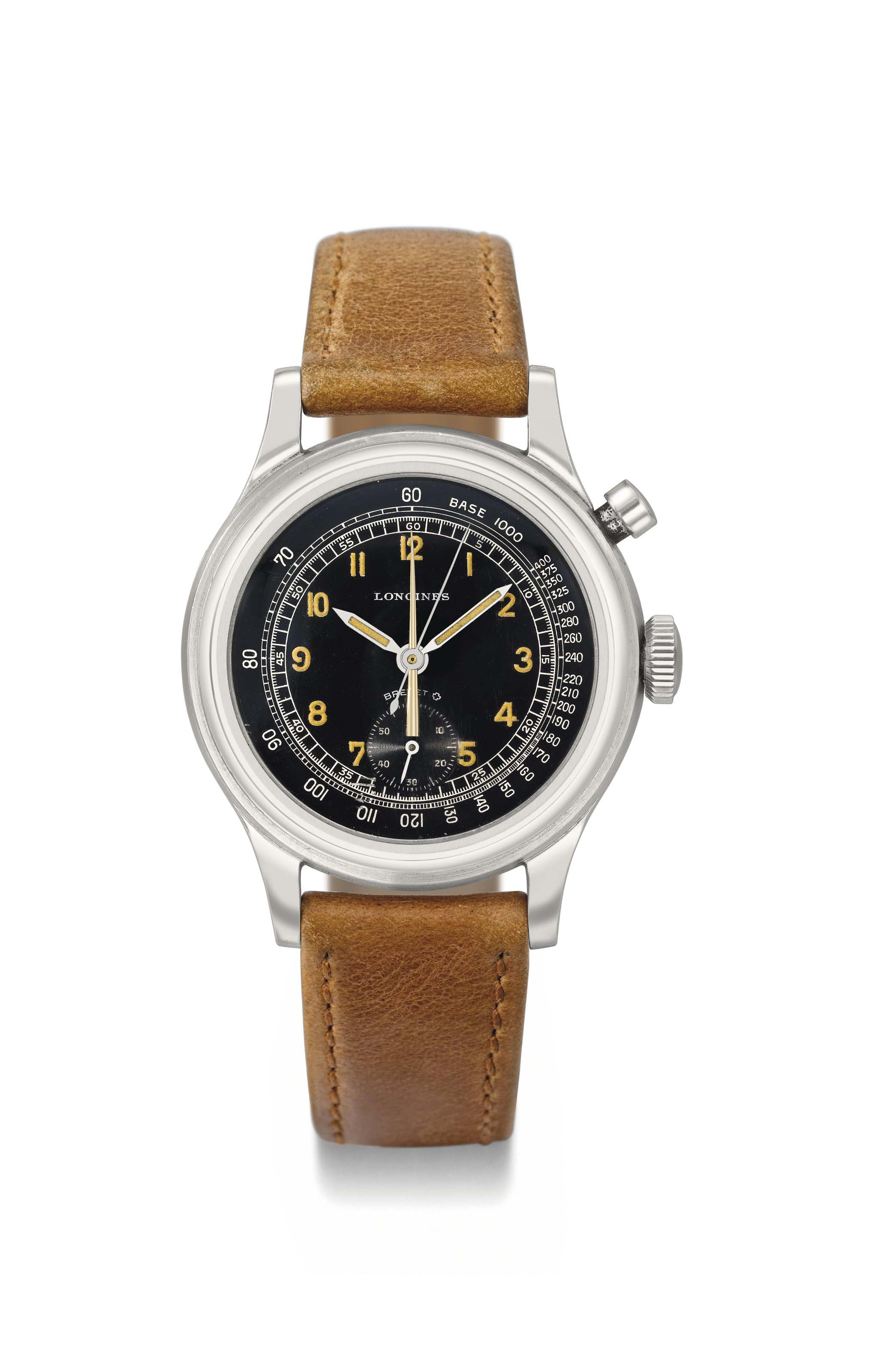 Longines. A rare and unusual stainless steel single button fly back chronograph wristwatch with black dial and central minute register
