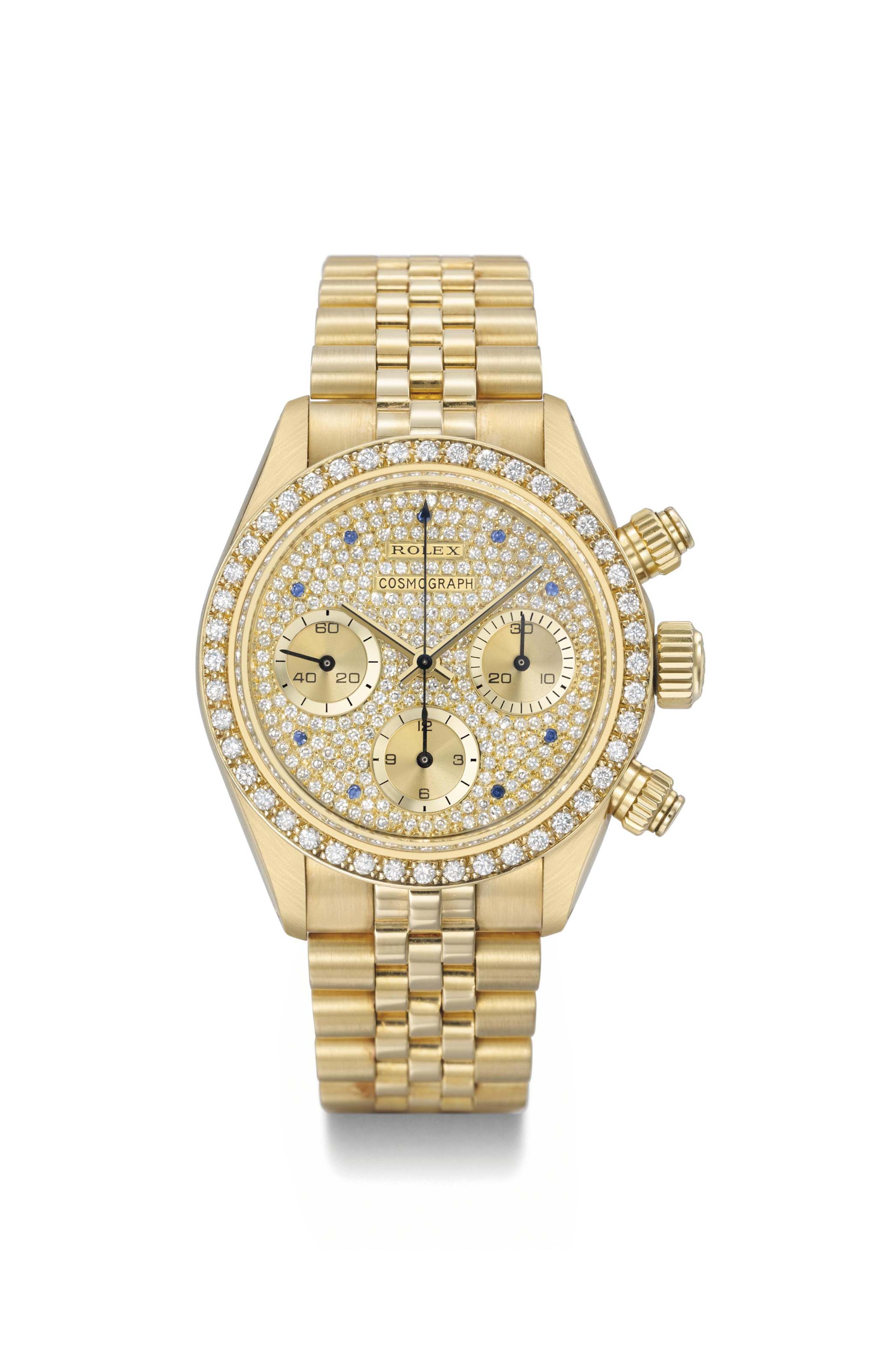 Rolex. An extremely rare and very attractive 18K gold, diamond and sapphire-set chronograph wristwatch with bracelet, original guarantee and box