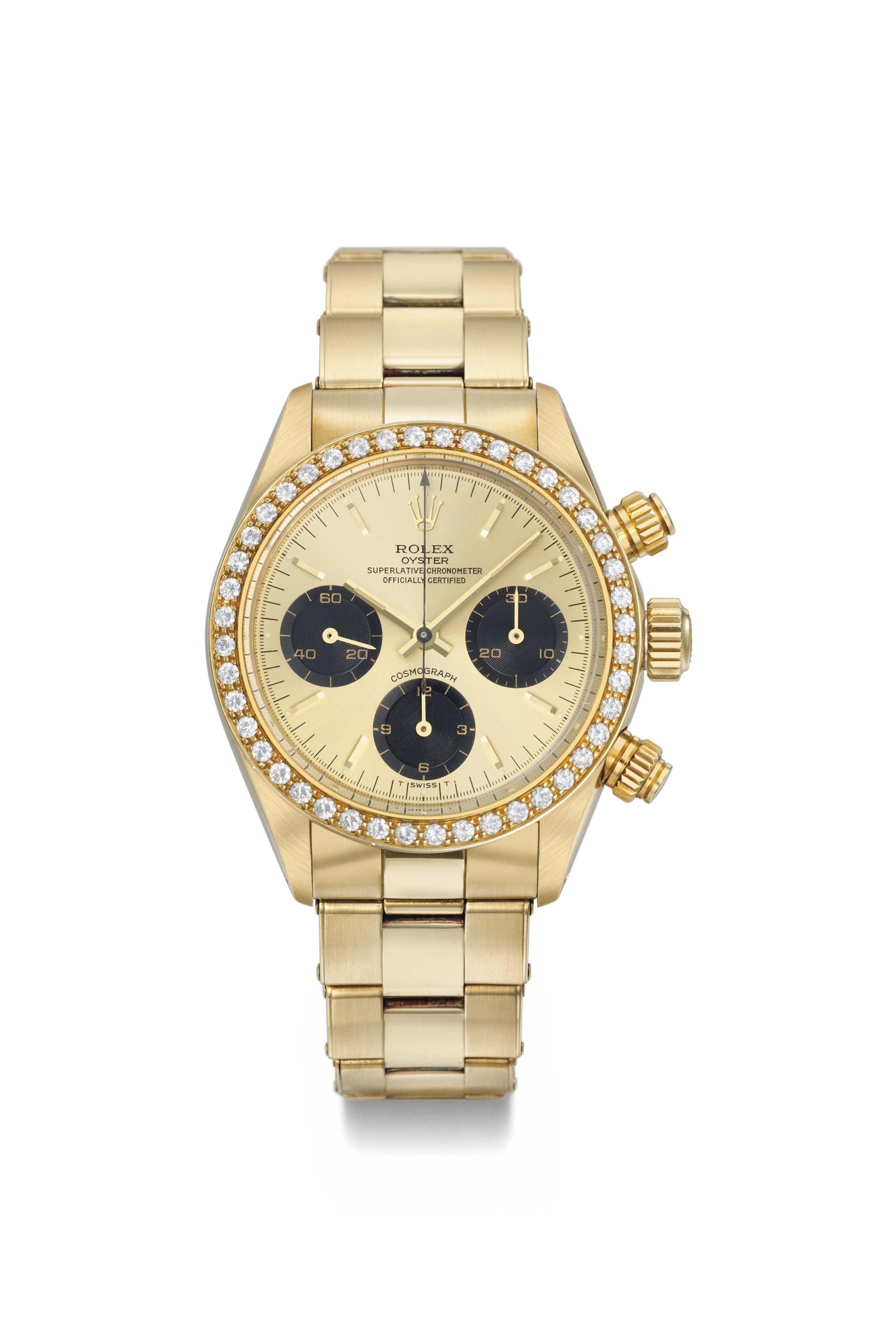 Rolex. An extremely rare and very attractive 18K gold and diamond-set chronograph wristwatch with bracelet, original guarantee and box