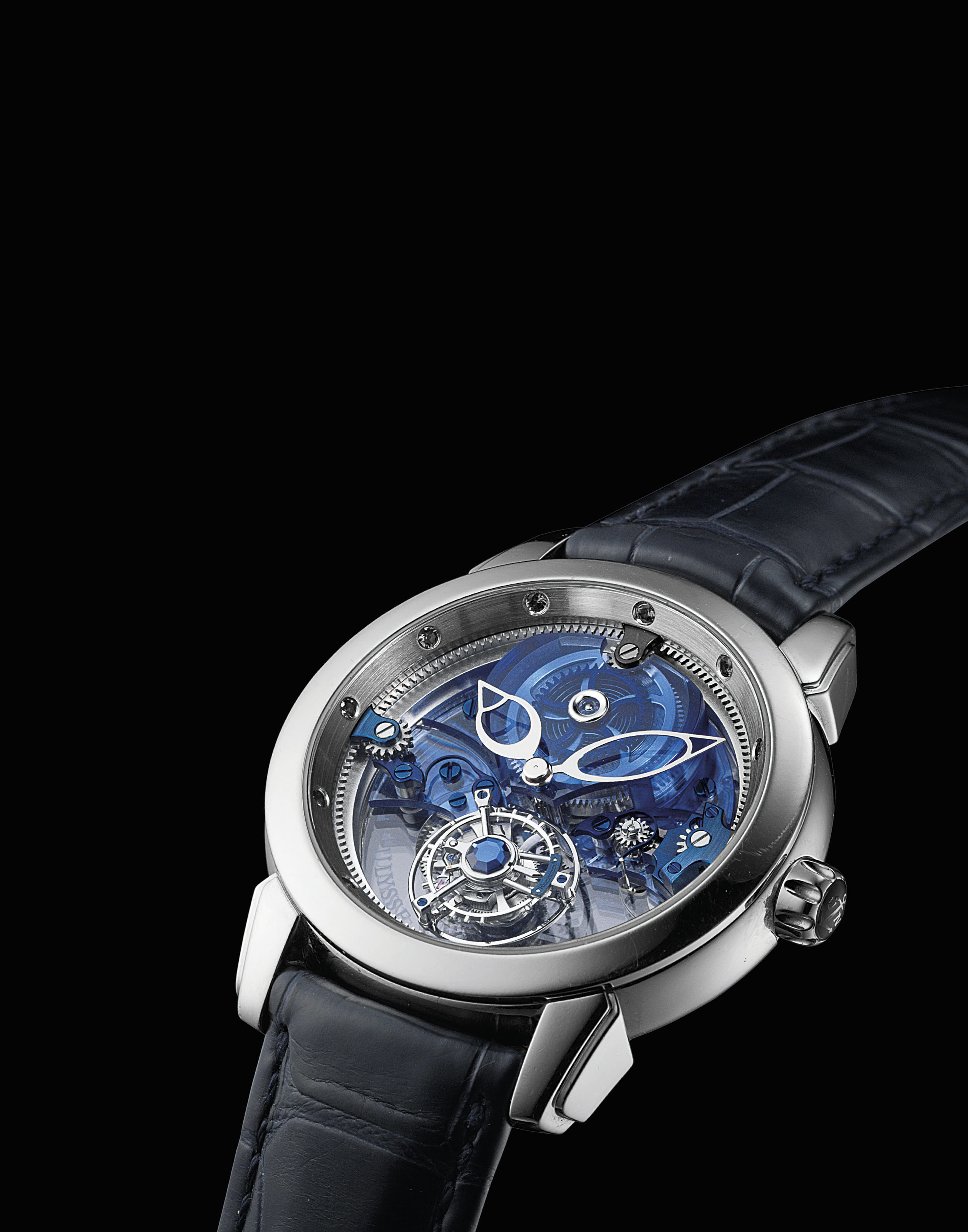 ULYSSE NARDIN. A FINE AND RARE PLATINUM AND SAPPHIRE-SET LIMITED EDITION SKELETONISED TOURBILLON WRISTWATCH