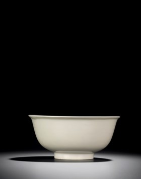 A RARE INCISED AND MOULDED WHITE-GLAZED BOWL