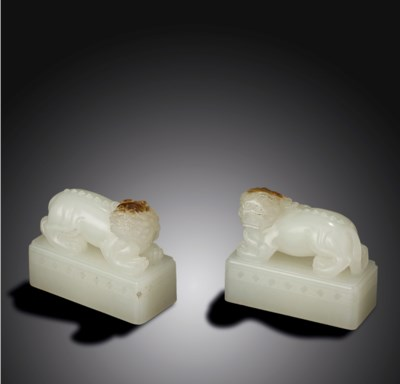 A PAIR OF WHITE JADE 'LIONS' S