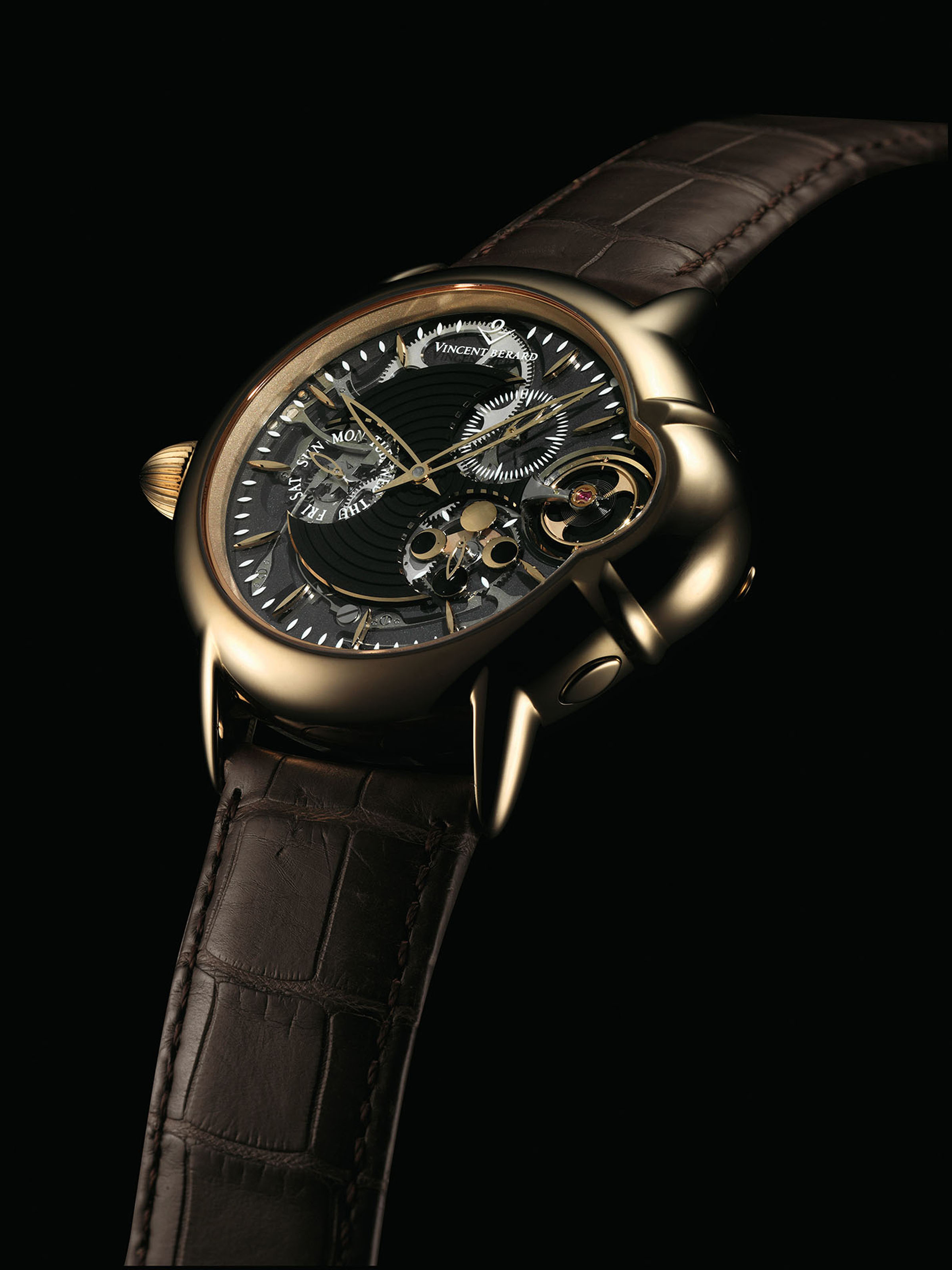VINCENT BERARD. AN 18K PINK GOLD LEFT-HANDED SEMI-SKELETONISED WRISTWATCH WITH MONTHLY LUNAR CYCLE AND DAY