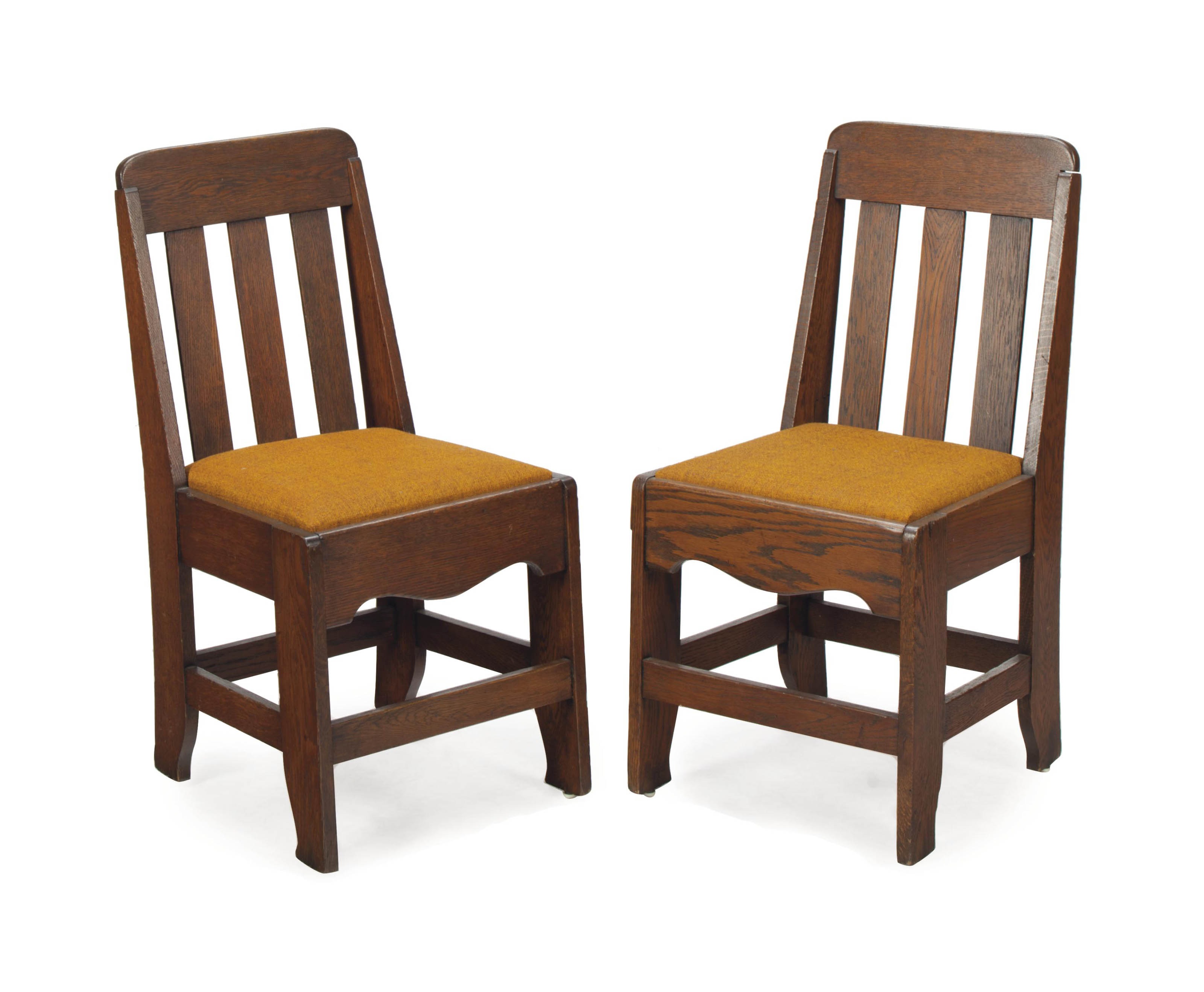 A Set Of Six American Arts And Crafts Oak Dining Chairs