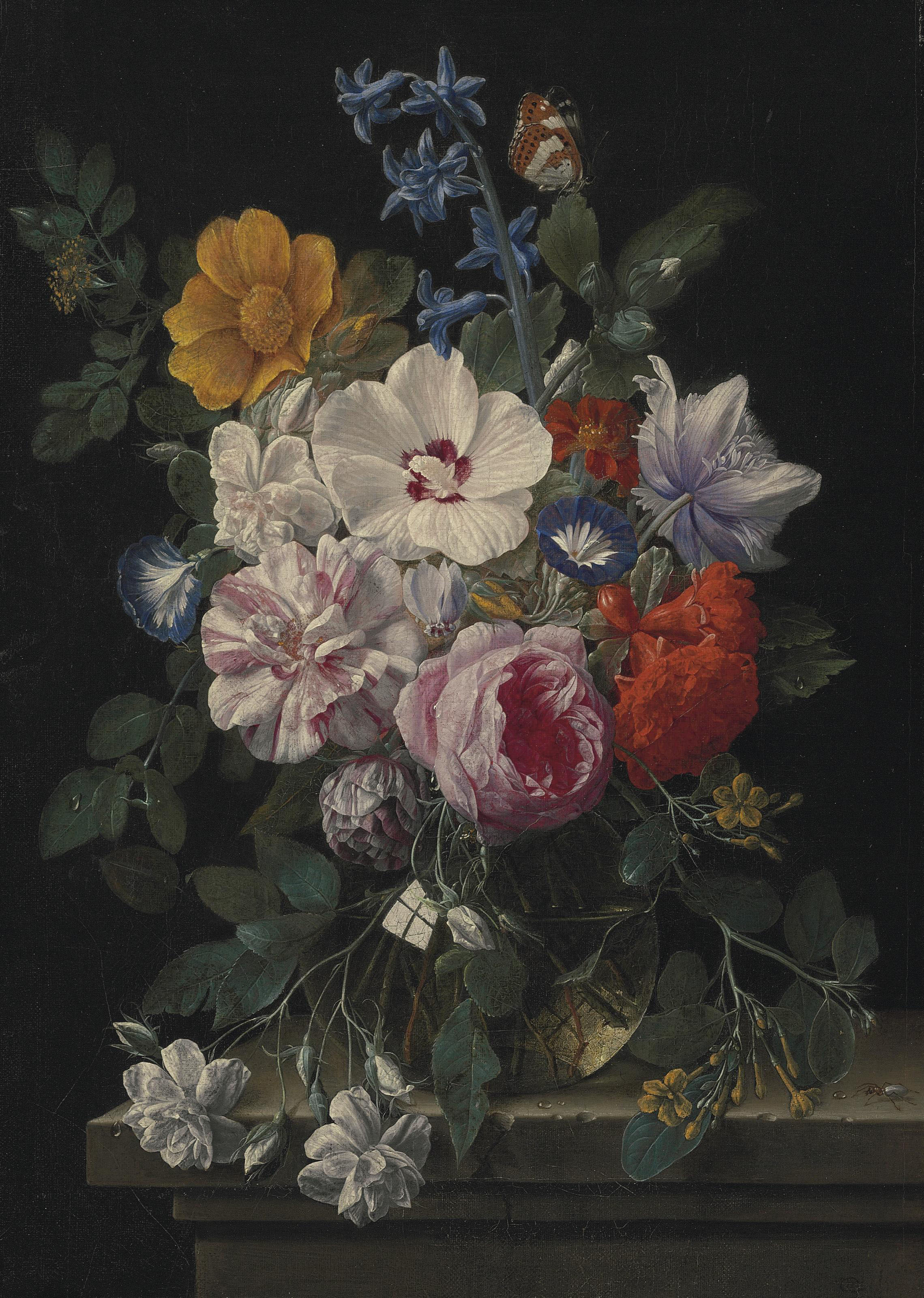 Flowers in a glass vase with a butterfly and beetle on a stone ledge