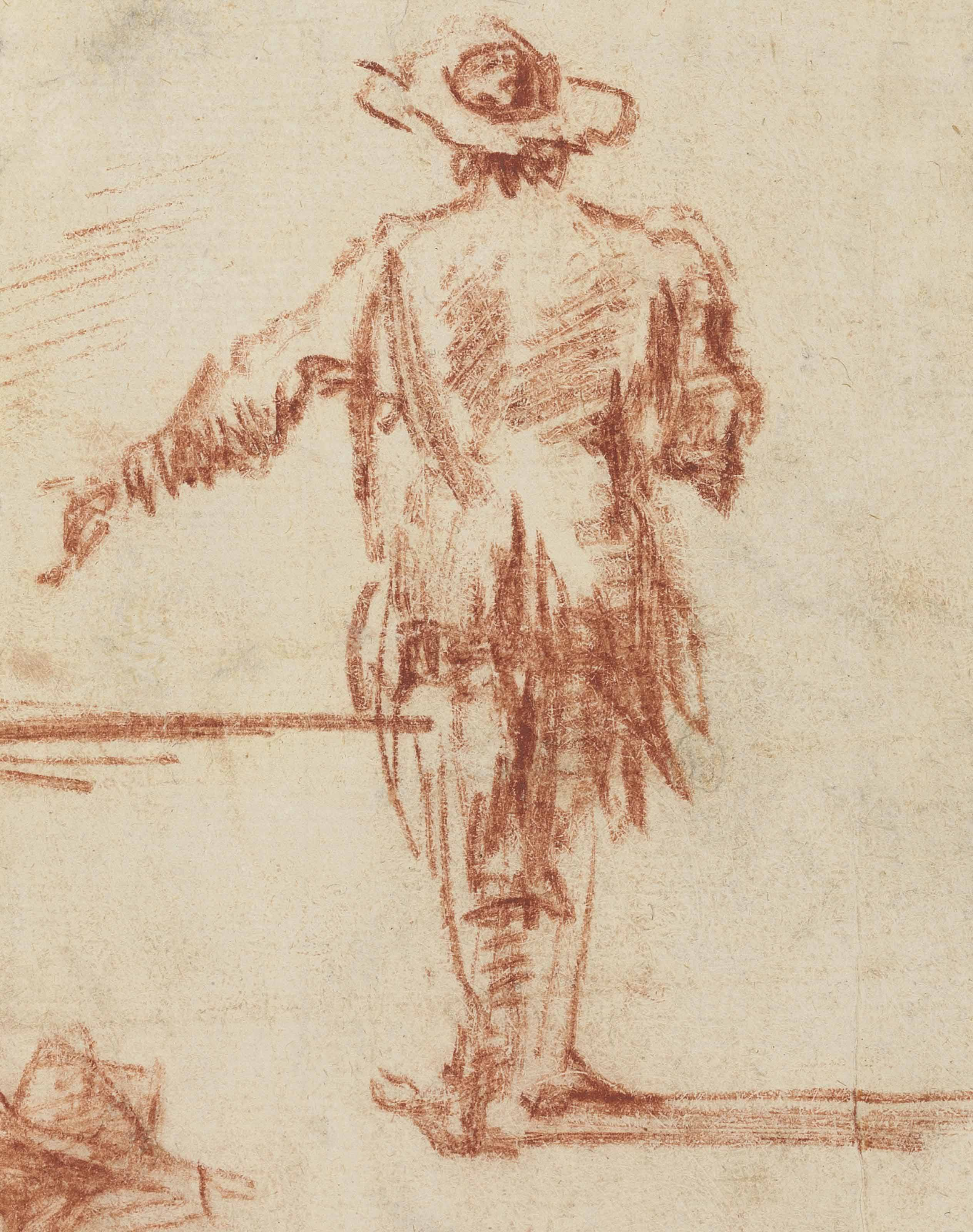 A standing man wearing a hat, seen from behind
