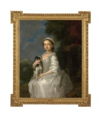 Portrait of a young girl, half-length, seated, in a white dress, a King Charles spaniel on her lap, in an ornamental park, with a hill-top castle beyond