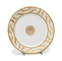 TWELVE FRENCH BISCUIT AND GILT-GROUND PORCELAIN PLATES,