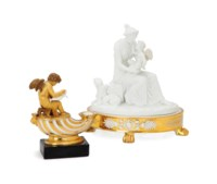A PARIS PORCELAIN INKWELL AND LINER, AND A GILT DECORATED BISCUIT PORCELAIN FIGURAL GROUP,
