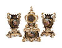 A FRENCH BLACK GROUND THREE PIECE PORCELAIN NEO-ROCOCO CLOCK GARNITURE,