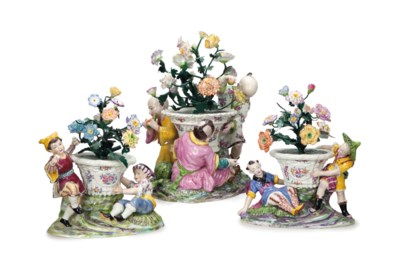 A FRENCH PORCELAIN AND TOLE TH