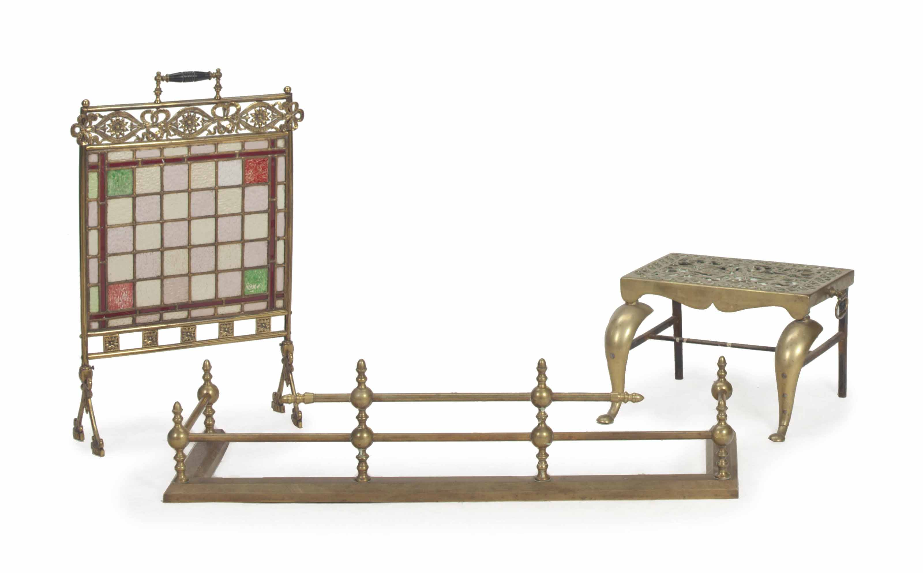 AN ASSEMBLED THREE-PIECE GROUP OF BRASS FIREPLACE EQUIPMENT,