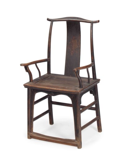 A CHINESE STAINED-ELM OFFICIAL
