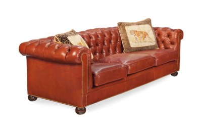 A BROWN LEATHER-UPHOLSTERED BU