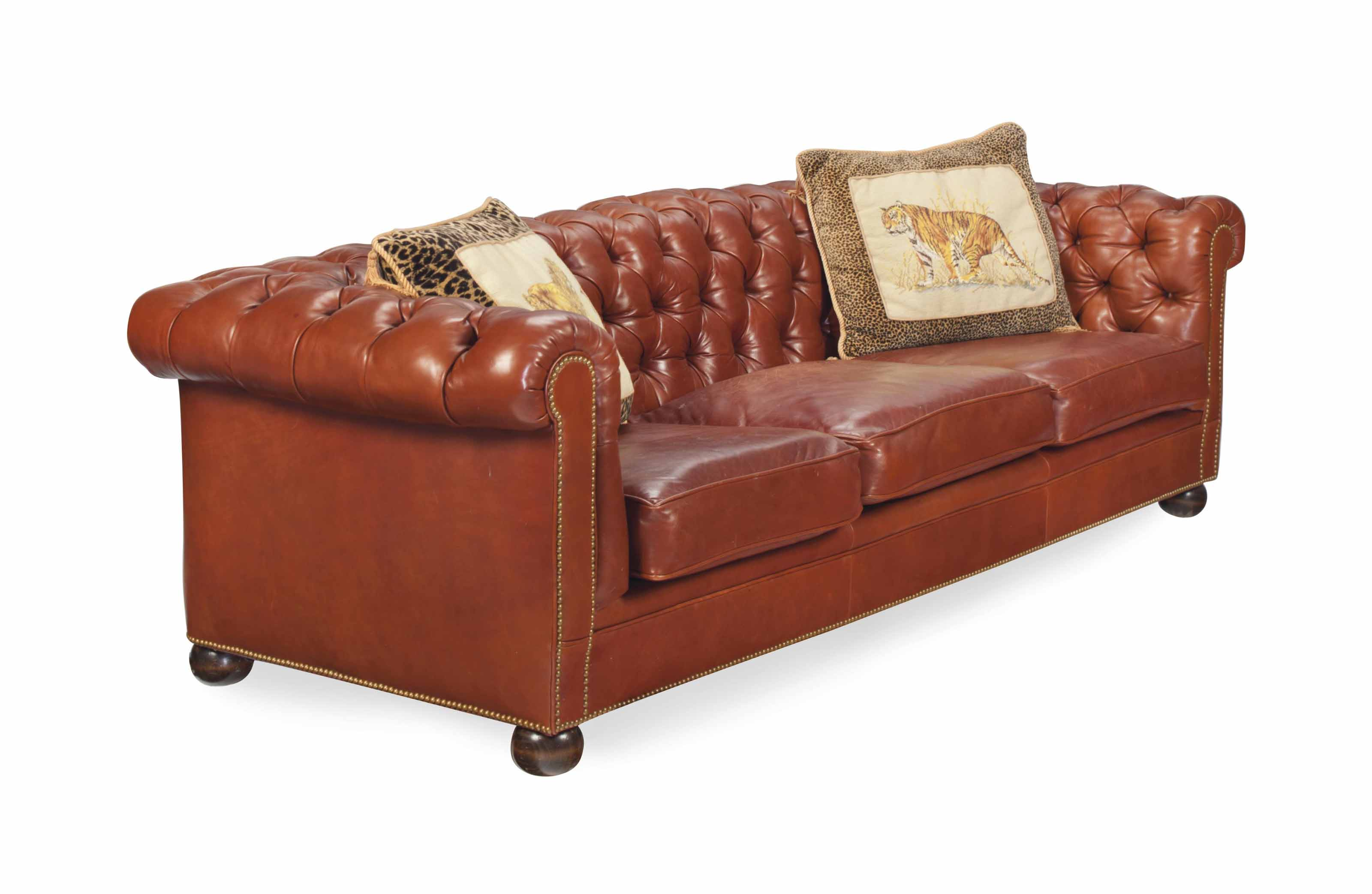 A BROWN LEATHER-UPHOLSTERED BUTTON-TUFTED SOFA,