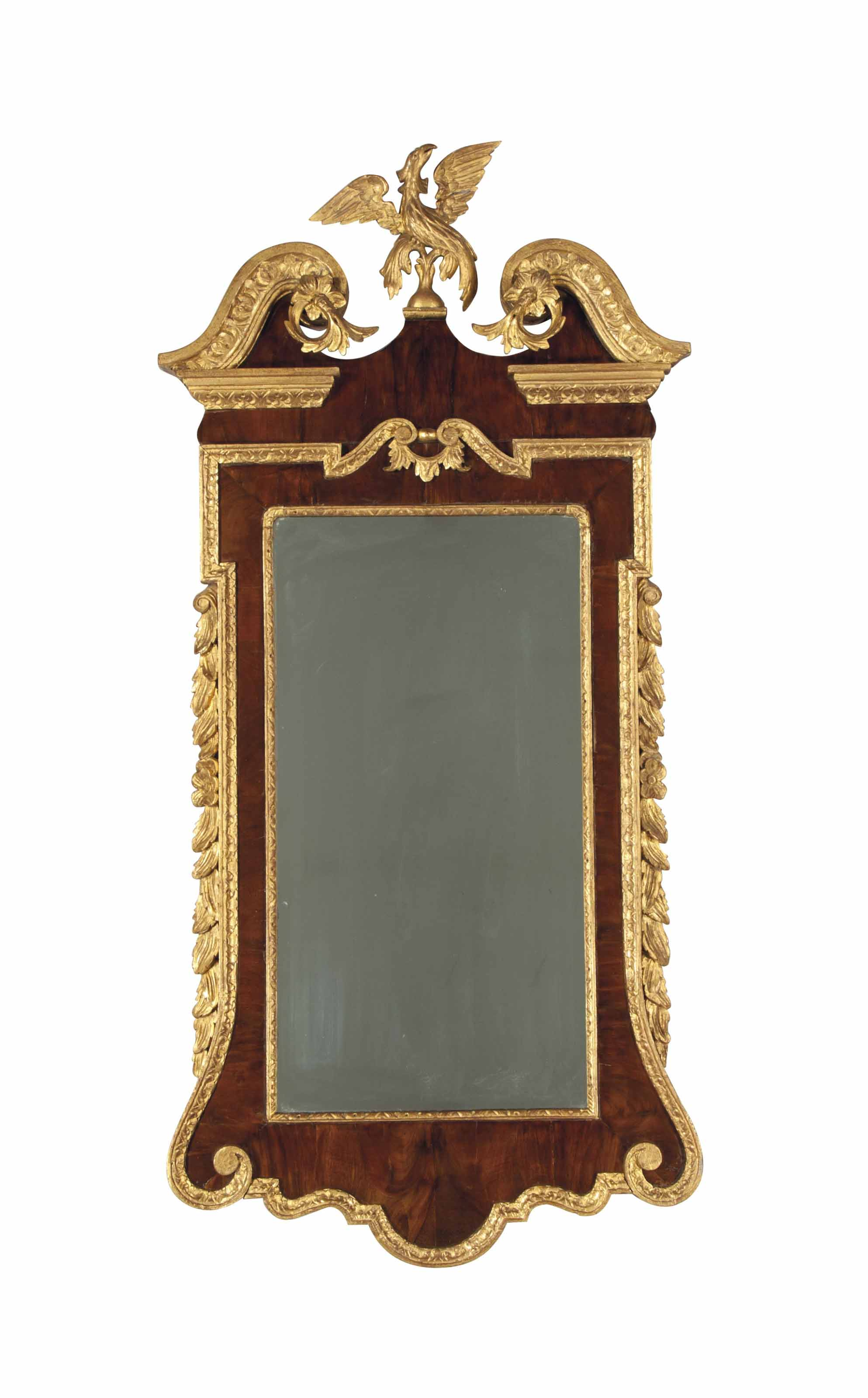 AN ENGLISH WALNUT AND PARCEL-GILT MIRROR,