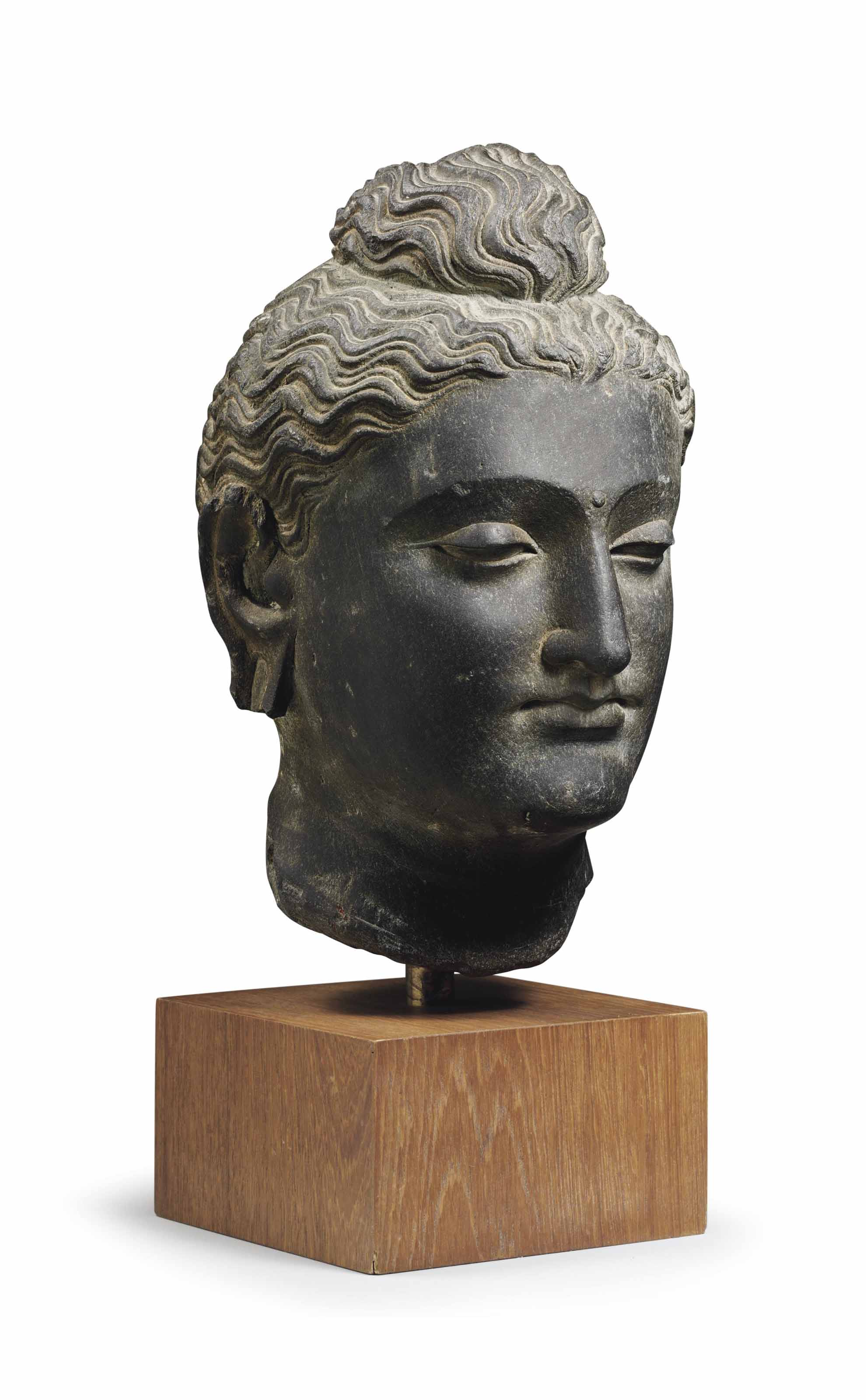 A Gray Schist Head Of Buddha Gandhara 2nd 3rd Century Sculptures Statues Figures Head Christie S