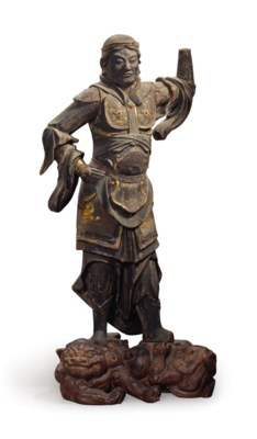 A wood figure of one of four G
