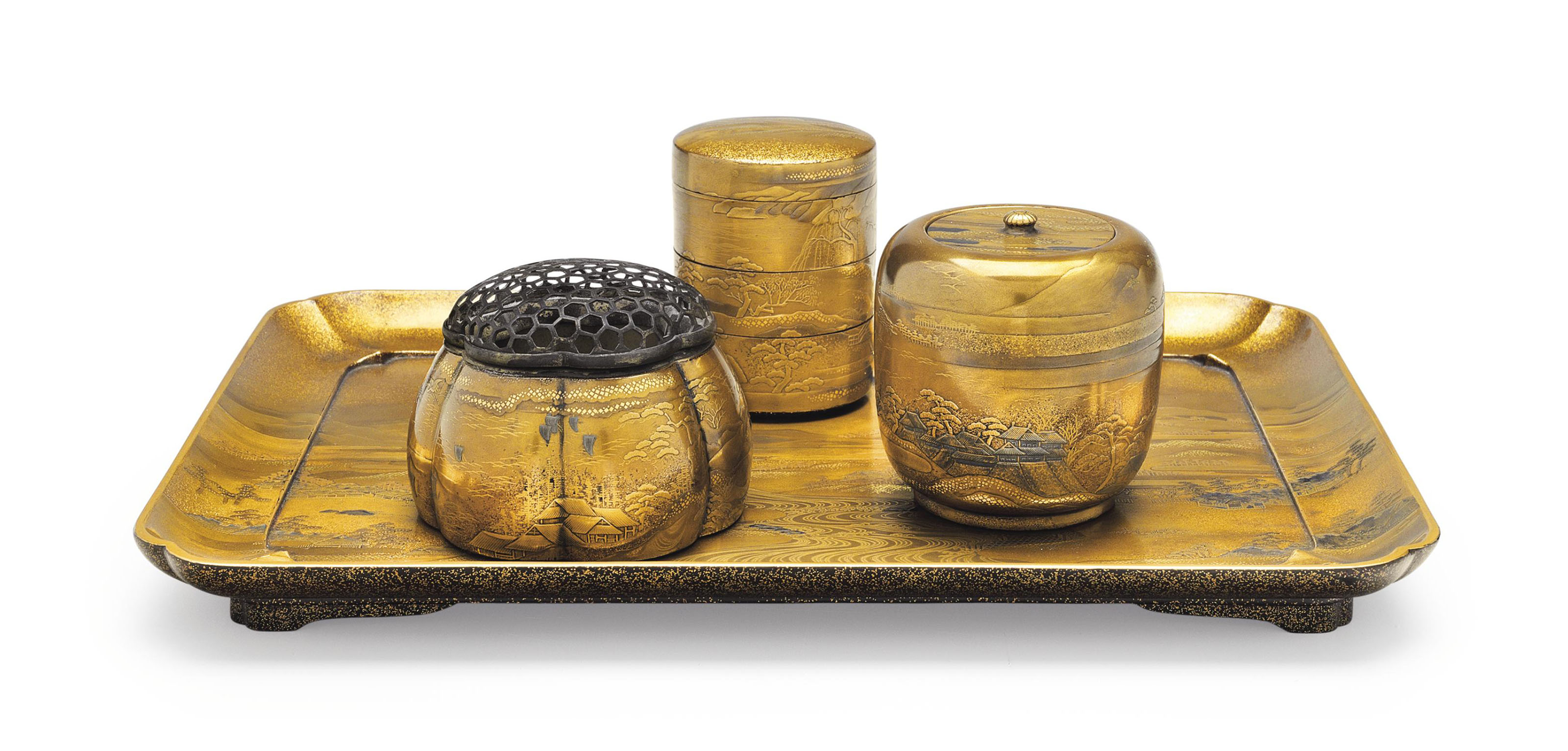 A set of four lacquer utensils