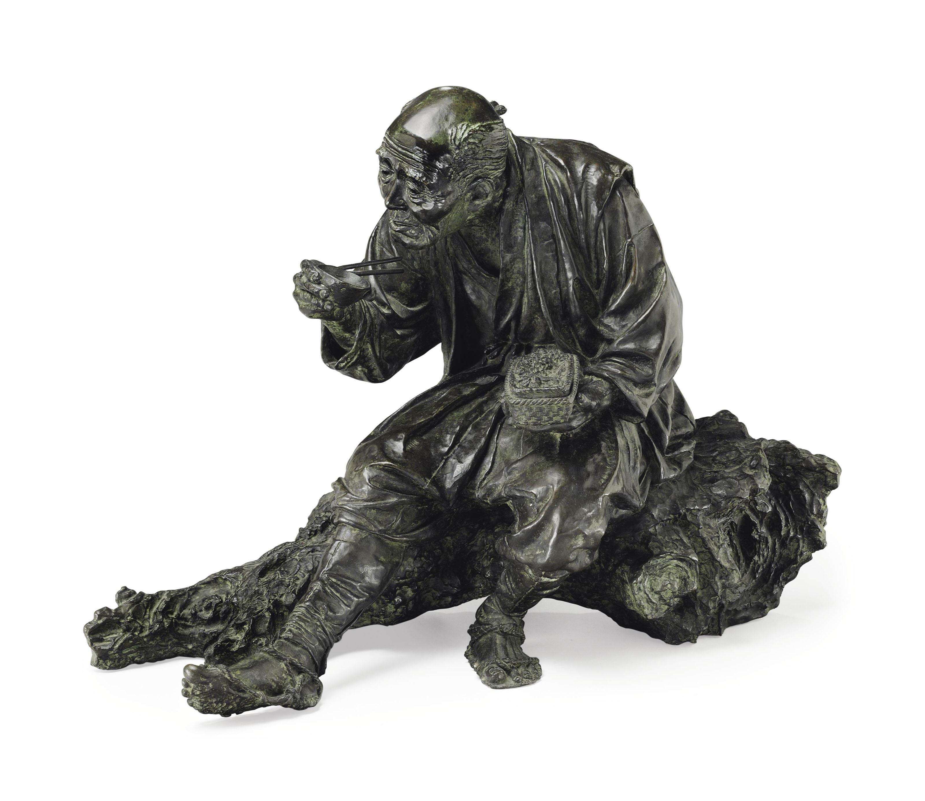 A bronze model of an old man
