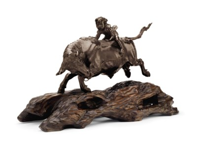 A bronze model of an oxherd ri