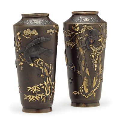 A pair of soft-metal-decorated
