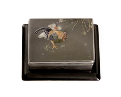 A soft-metal inlaid silver box