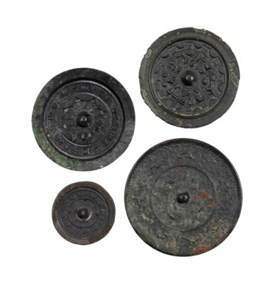 FOUR SMALL CHINESE BRONZE CIRC