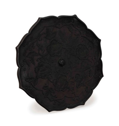 A LARGE BRONZE LOBED MIRROR,