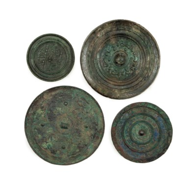 FOUR CHINESE BRONZE CIRCULAR M