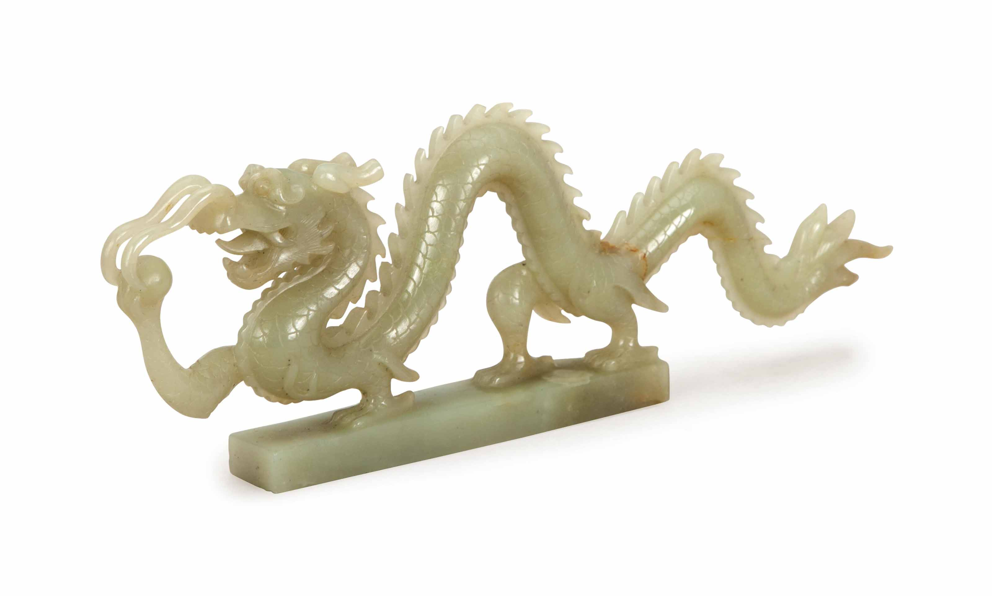 A CHINESE PALE GREEN JADE FIGU