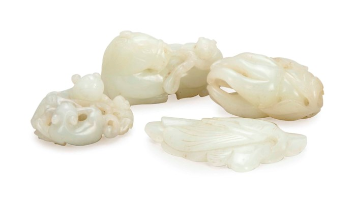 FOUR CHINESE WHITE JADE CARVIN
