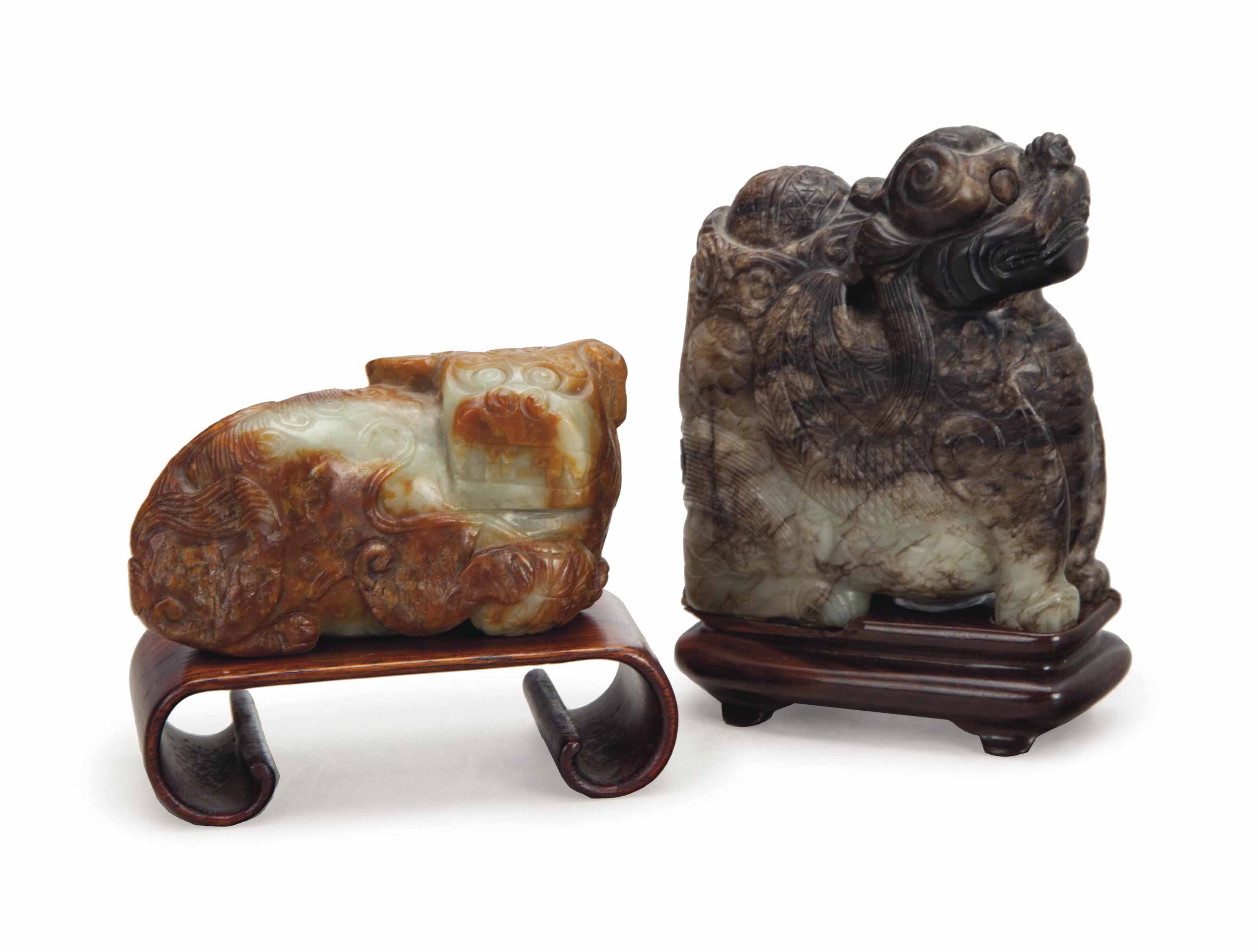 TWO CHINESE MOTTLED JADE FIGUR