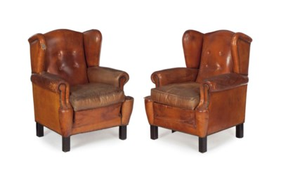 A PAIR OF LEATHER WINGBACK ARM