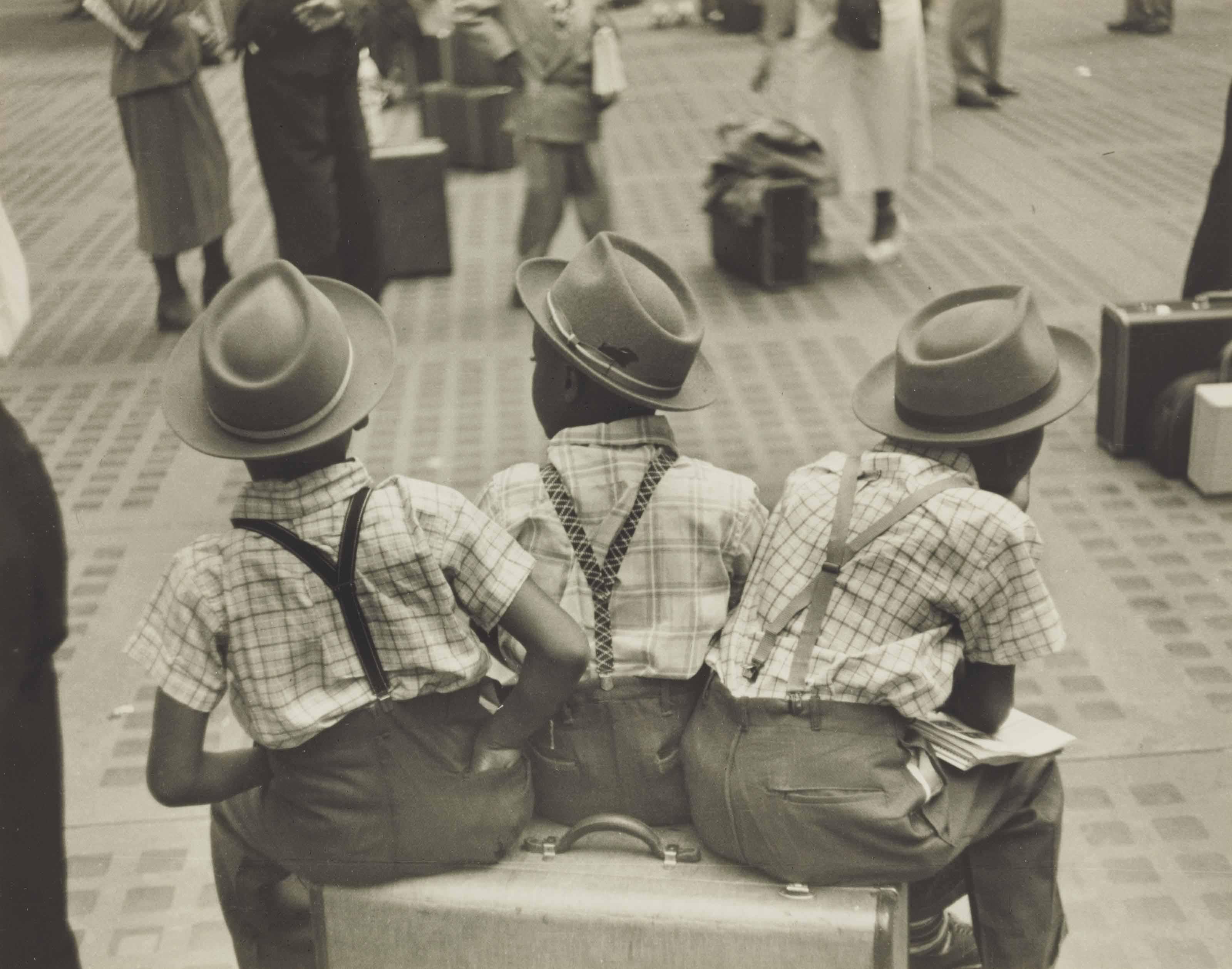 Three little boys on suitcase, Penn Station, c. 1947