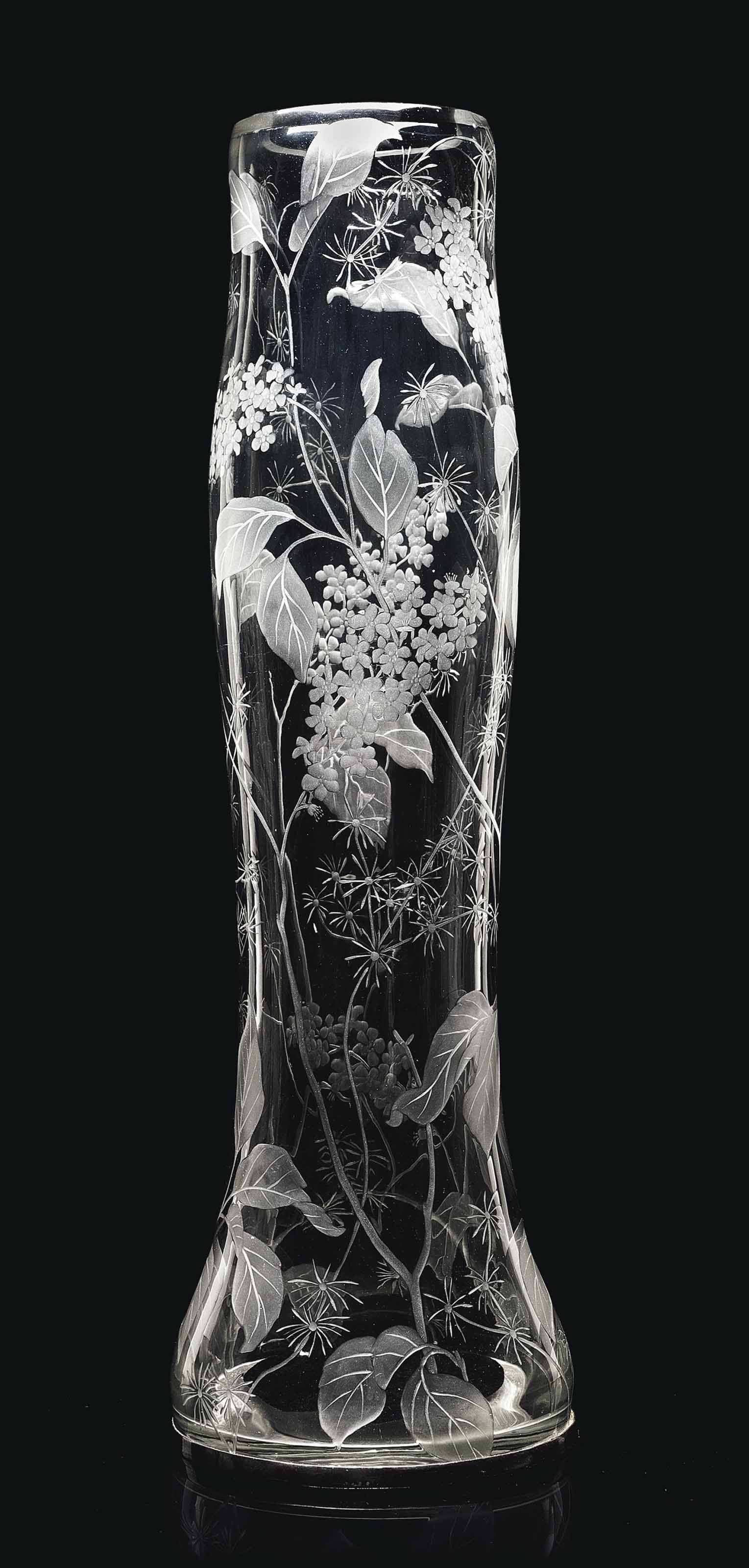 A LARGE CUT-GLASS VASE