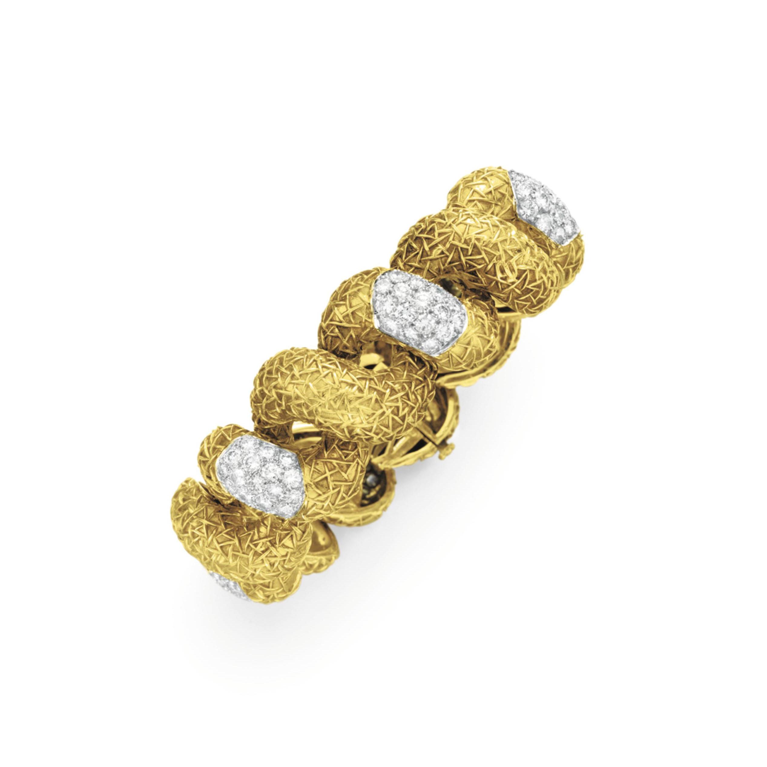 A DIAMOND AND GOLD BRACELET, BY WANDER