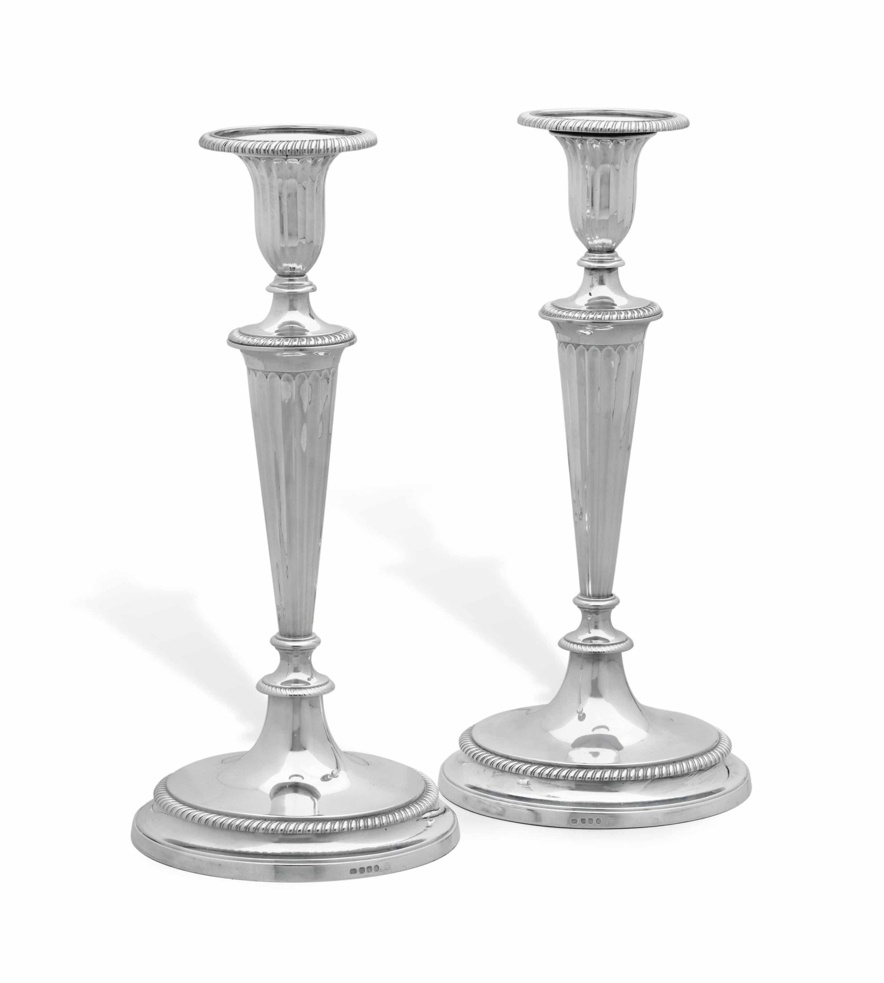 A PAIR OF GEORGE III SILVER CANDLESTICKS