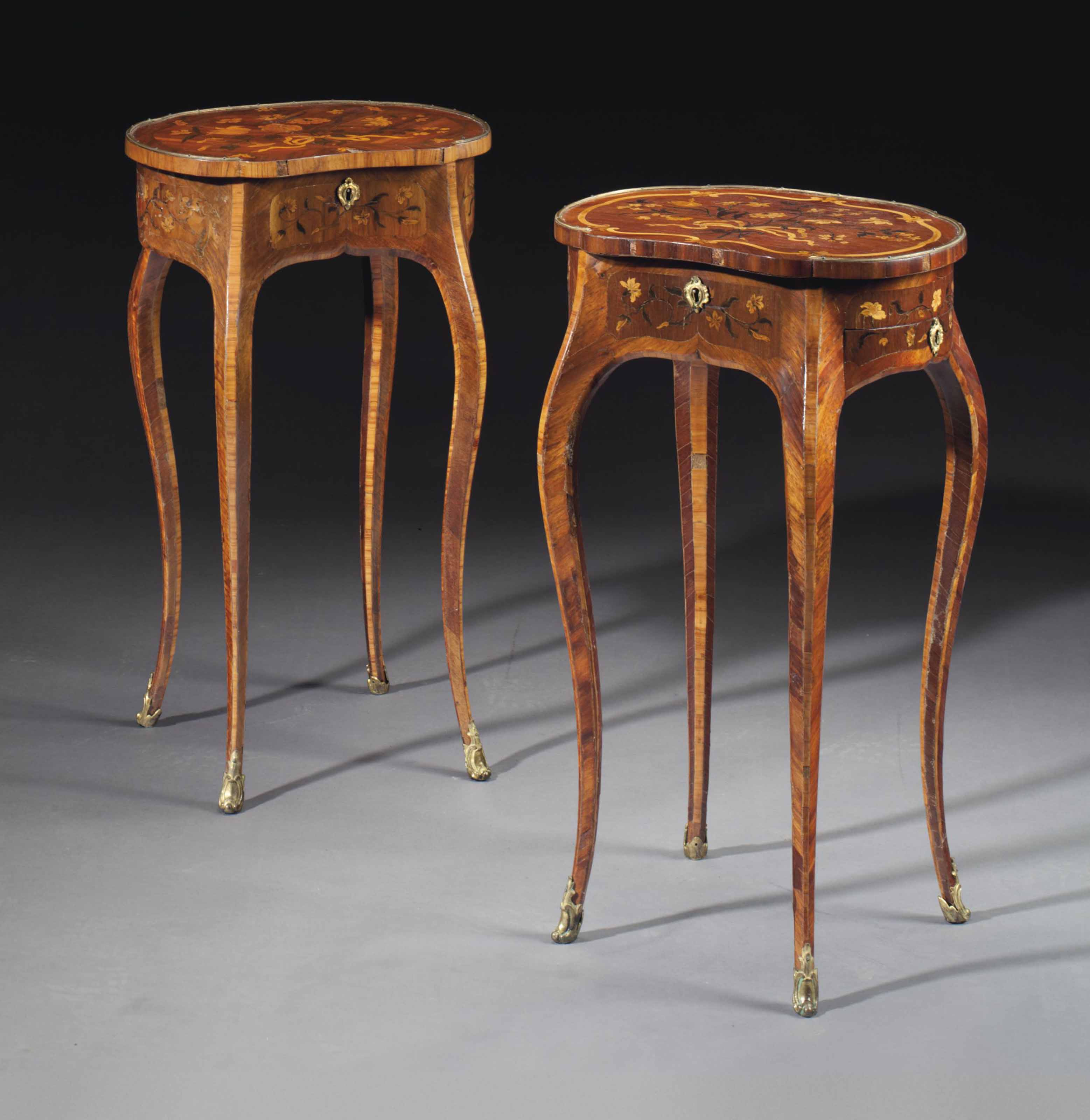 A NEAR PAIR OF LOUIS XV ORMOLU-MOUNTED BOIS SATINE, AMARANTH, TULIPWOOD AND MARQUETRY OCCASIONAL TABLES
