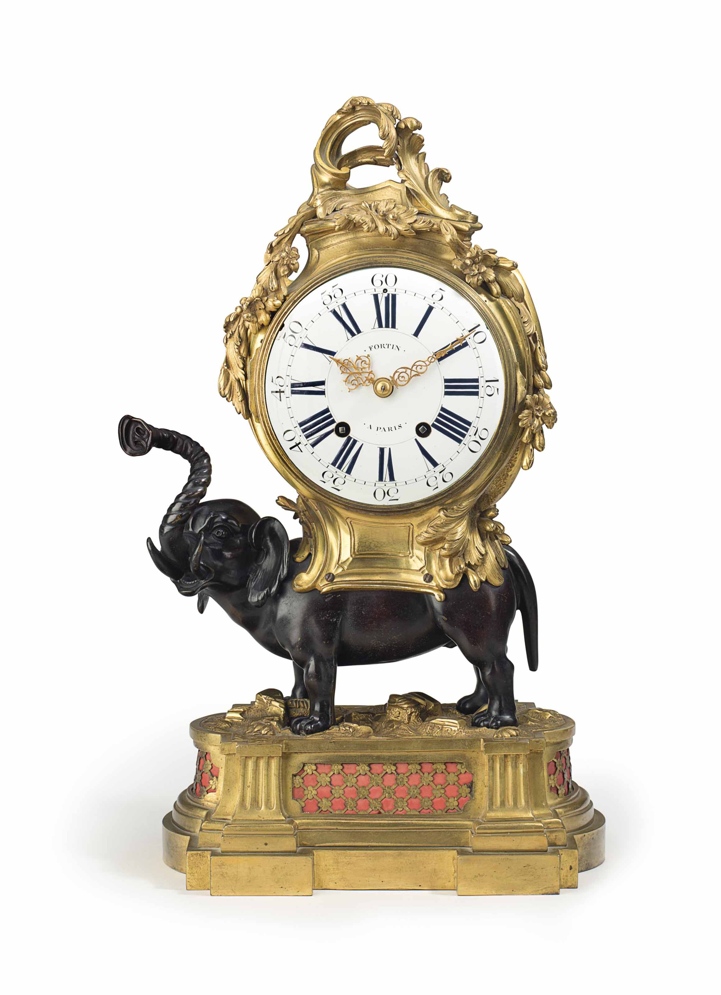 A FRENCH ORMOLU AND PATINATED BRONZE QUARTER STRIKING MANTEL CLOCK