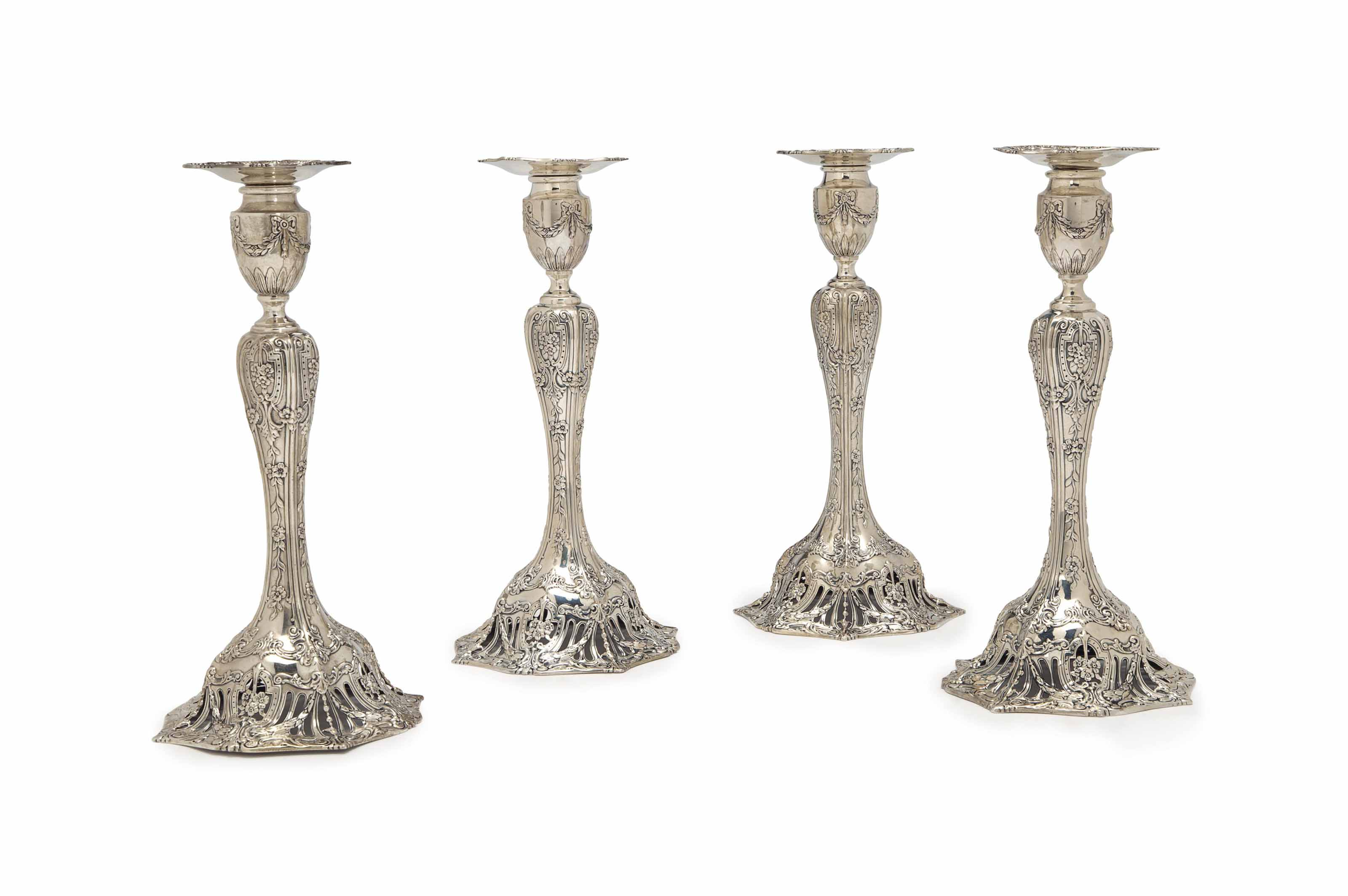 A SET OF FOUR AMERICAN SILVER CANDLESTICKS,