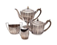 AN ASSEMBLED GEORGE III SILVER TEA AND COFFEE SERVICE,