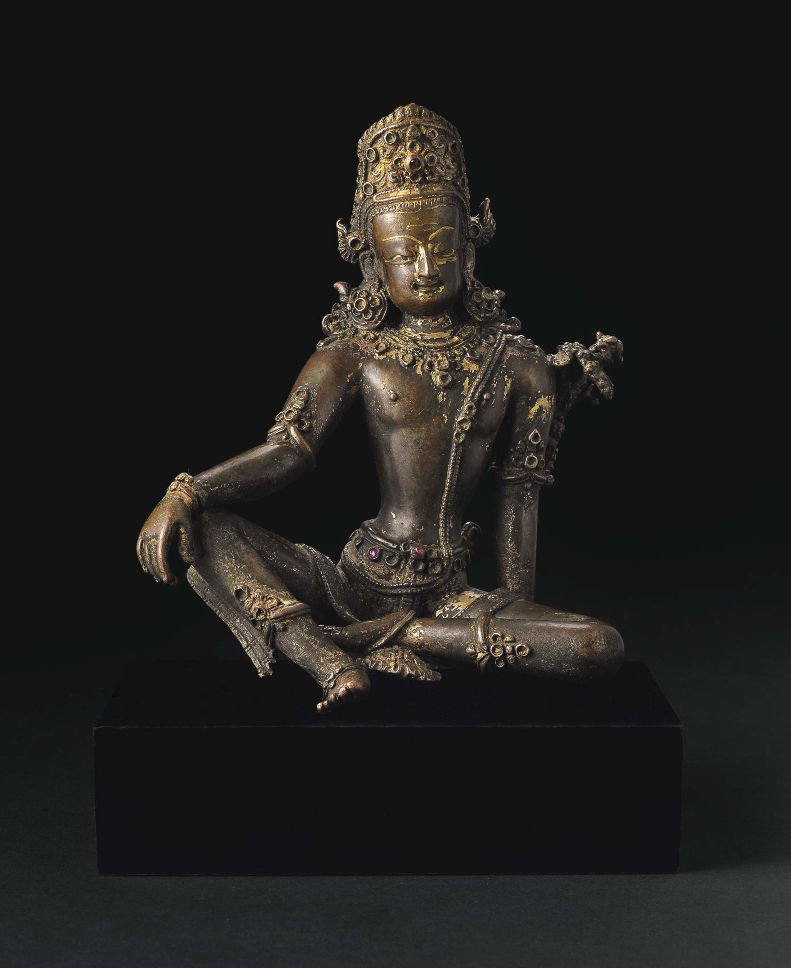 A bronze figure of Indra