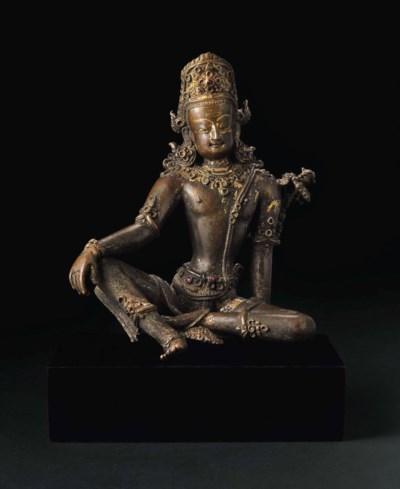 A bronze figure of Indra