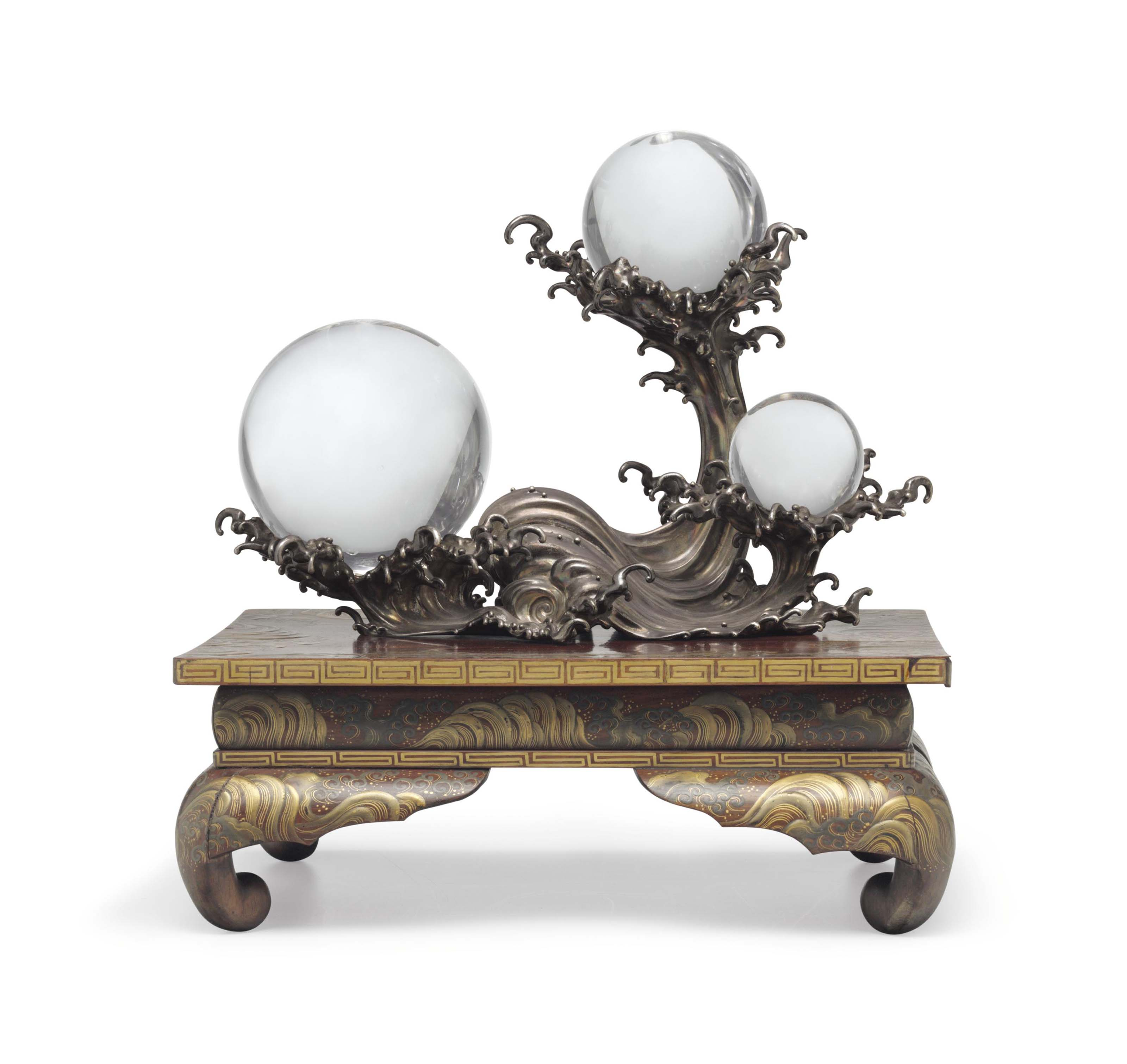 Three crystal spheres on a silver stand