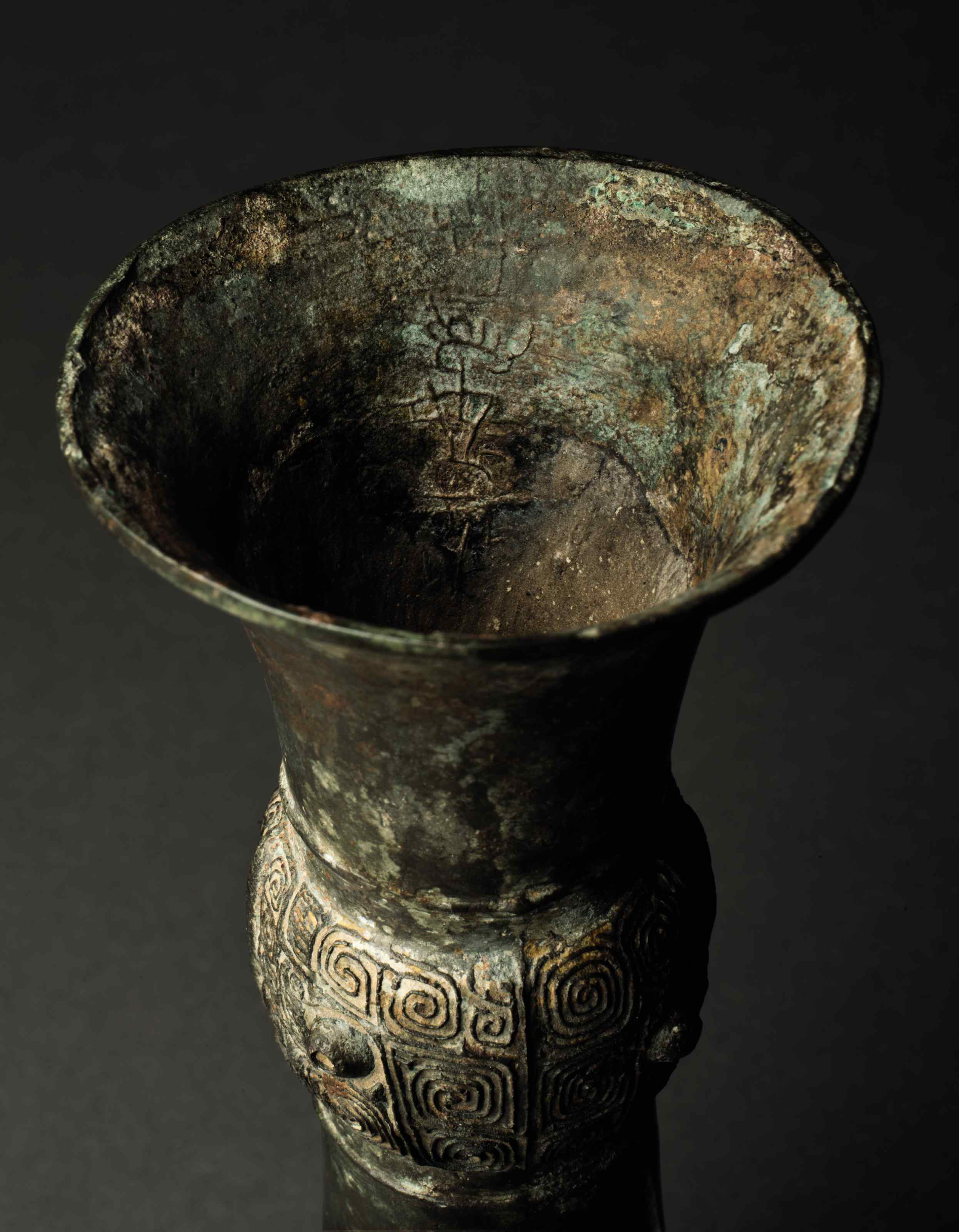 A SMALL BRONZE RITUAL WINE VES
