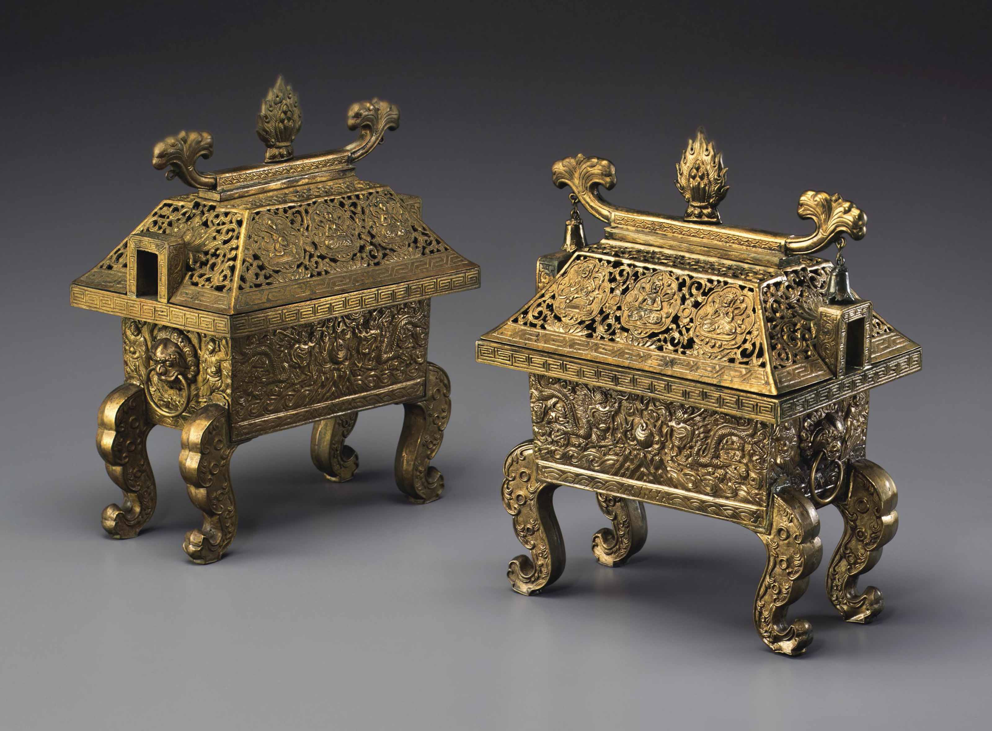 A PAIR OF GILDED REPOUSSE COPP
